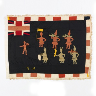 Black flag with alternating squares of red and white forming a border. Flag depicts an all-female militia confronting a male intruder who reacts with fear to their presence. The two women closest to the intruder carry a flag and a drum while the others carry rifles and a machete. A small British flag appears in the upper left hand corner. The initials of the militia are embroidered along the bottom edge. The flag is fringed on three sides.