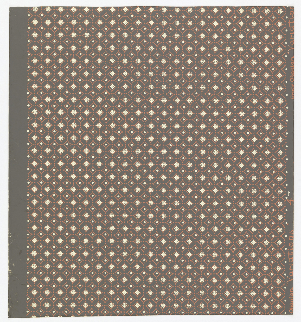 Diaper of columns of broken circles outlined in red, centered with white flowers. White dots in the segmented spaces between. Perhaps adapted from Japanese.
