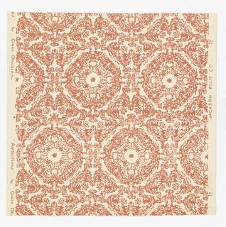 Purple-pink repeating medallions resembling basket work. Printed on cream ground.