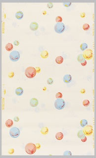Bathroom or powder room paper. Pink, green, and blue bubbles with yellow and red highlights and grey shadows on a cream ground.