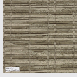 Imitation window shade with brown wooden slats on a beige ground.