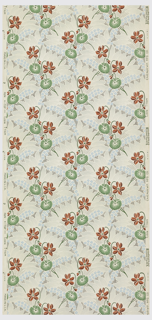 Red and green flowers on a background of wavy blue and grey lines forming a lattice pattern on a cream ground.