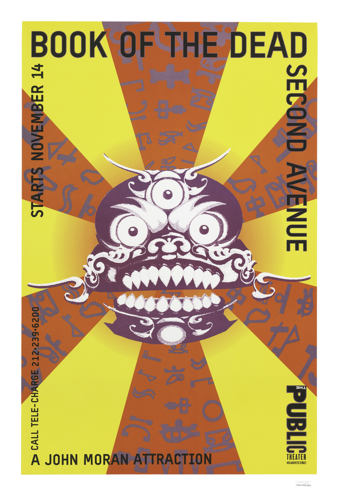 A purple open-mouthed mask with three eyes and grimace with sharp teeth on a ground of yellow with radiating bands of red covered with purple symbols. On perimeter, text reads: BOOK OF THE DEAD SECOND AVENUE [Public Theater logo]; A JOHN MORAN ATTRACTION / STARTS NOVEMBER 14.