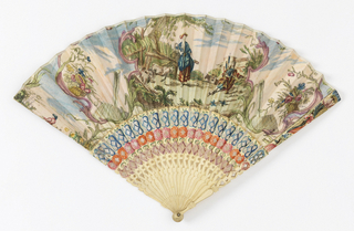 Pleated fan. Paper leaf with hand-colored etching. Obverse: shepherd and shepherdess. Reverse: country scene with a garlanded monument in the background. Ivory or bone sticks carved à jour, painted red, blue and violet. Designs of flowers on guards with colored foil behind.