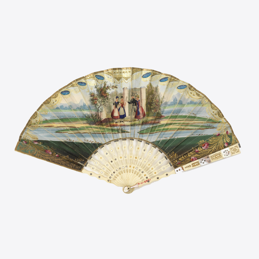 Pleated fan. Gilded paper leaf with hand-colored lithograph. Obverse: a finely dressed man and woman meeting two rustic women on an island. Reverse: Two men and two women around a statue. Pierced ivory sticks with spangles and mother-of-pearl plaques.