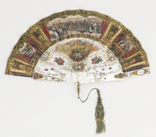 Pleated fan. Gilded paper leaf with lithographs. Obverse: purple and copper-colored paper gilded showing three proscenium arches with curtains and pseudo-Renaissance motifs framing hand-colored lithographs of theatrical Spanish scenes. At left, a drinking party in fancy dress; at center, a large masked ball; at right, a queen and three attendants in a loge. Reverse: Three framed hand-colored lithographs of Spanish scenes in mountainous country. At left, two women at a well listening to minstrels; in center, groups of men at leisure with horses and riders; at right, men with a donkey. Gilded mother-of-pearl sticks, brilliantly painted on obverse and reverse with birds, flowers and scrolls.  Reverse sticks decorated with small painted lithograph of Chenonceau. Oval mirror with gold frame set in guards. White paste jewel rivet head; gilt metal bail. Pale green silk tassel with gilt ornaments and beads.