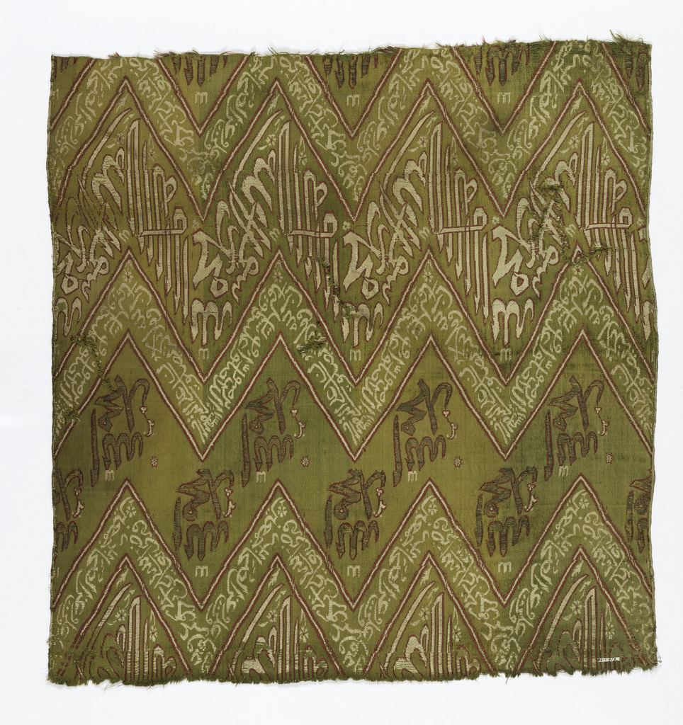 Fragment of woven silk with Zigzag bands of kufic script in cream and red on a yellow-green ground.