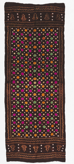 Black silk ground with a tie-dyed design of six-pointed stars and squares in cerise, green, yellow, orange and white. Narrow borders on the long sides and deep borders on the short sides, with tie-dyed designs of zigzags and unidentified shapes.