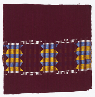 Reversible square fragment of dark red, with a center band of blue, yellow and white weft floats which form a geometric pattern.
