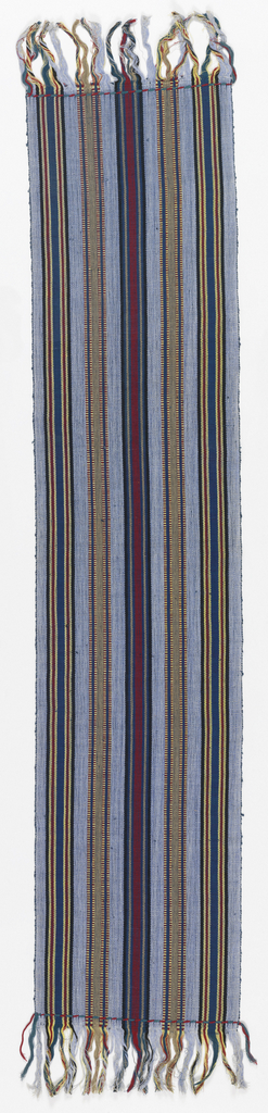 Tie used by Nigerian women to fasten babies to themselves. Long narrow rectangle with stripes of blue, black, yellow, red and brown. Fringed at both ends.