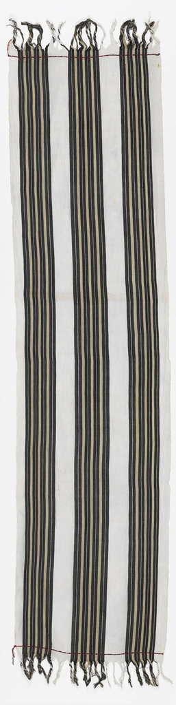 Length of white cotton with three broad stripes in black and tan. Fringed at both ends.