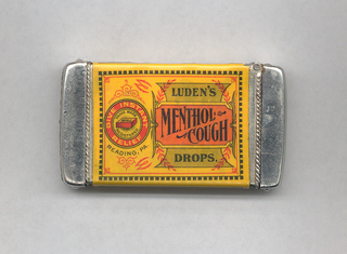 "Rectangular, rounded corners, image/text reads horizontally, inscribed ""Luden's Menthol Cough Drops"" on right, and ""Give Instant Relief,"" ""Trade Mark,"" ""WHL,"" ""Reading, PA."" on left, printed in black and orange on yellow-gold ground, and imposed on variously shaped reserves, all framed with an array of decorative flourishes; upper side panel inscribed ""Name on every drop,"" lower side panel inscribed ""Sold Everywhere,"" reverse inscribed ""All persons troubled with coughs, cold hoarseness, sore throats, etc., will find immediate relief by using these drops. Public speakers, Singers, etc., are invited to try them. One of these drops put into the mouth before going to bed, loosens the phlegm and causes the patient to enjoy a comfortable night's sleep. Manufactured by W.H.Luden, 5 Cents, Reading, PA."" Lid hinged on long side. Striker in recessed groove on bottom."