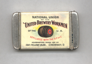 "Rectangular, rounded corners, image/text reads horizontally, inscribed ""National Union of the United Brewery Workmen of the U.S. Affiliated with the A.F. of L., Headquarters: Rooms 109-110, Odd-Fellows Bldg., Cincinnati, O.,"" all in alternating type-faces in black and red, image of brown and black wooden barrel at center, with blue and yellow highlights, inscribed in very small letters on red ""Union Beer."" Lower side panel inscribed ""United We Stand,"" upper side panel inscribed ""Divide and We Fall."" Reverse inscribed ""This label should be pasted on every package containing Beer, Ale, or Porter, as the only guarantee that said package contains beverages produced by Union Labor."" Central reserve features facimile of red label, featuring blue coat of arms flanked by inscription ""UNION"" and ""BEER"", the rest inscribed ""National Union of the United Brewery Workmen of the United States."" Lid hinged on long side. Striker in recessed groove on bottom."