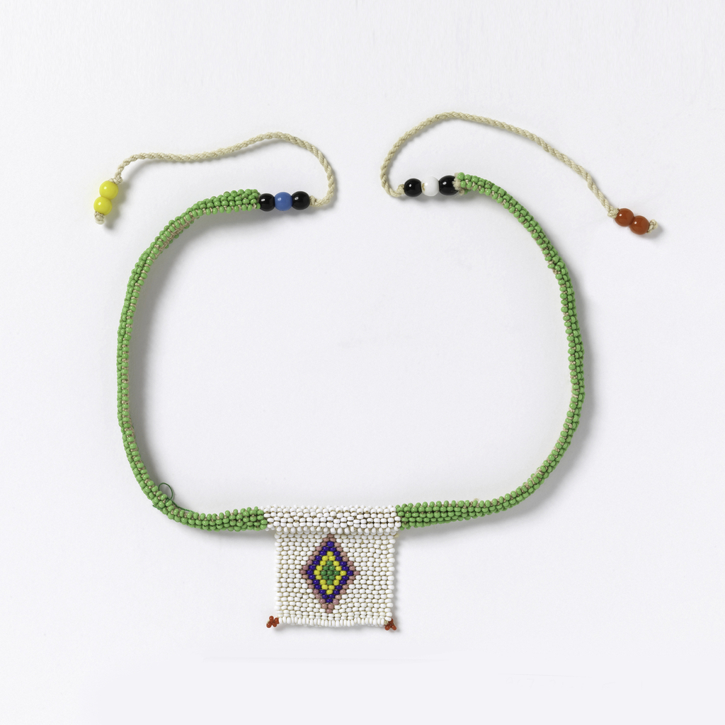 """Necklace known as a """"love letter."""" Small white beaded square with a multicolored diamond, suspended from bright green beaded strings. The various color combinations and designs convey messages connected with courtship."""