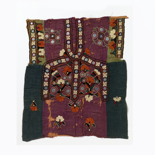 Blouse front with uncut neck slit embroidered with coloured silks and decorated with small mirrors in a symmetrical design. Constructed from a variety of plain weave fabrics sewn together with a running stitch.