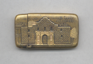 """Rectangular, rounded corners and sides, image/text horizontally orientated, featuring raised decoration of Alamo facade, inscribed """"The Alamo, Greetings from San Antonio,"""" identical decoration on reverse. Lid hinged on long side. Striker on bottom."""