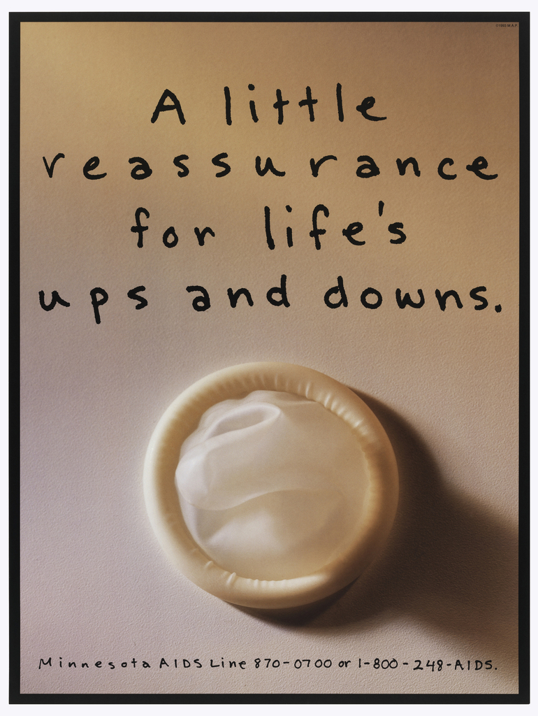Photograph of a skin-colored condom with handwritten note: A little / reassurance / for life's / ups and downs.