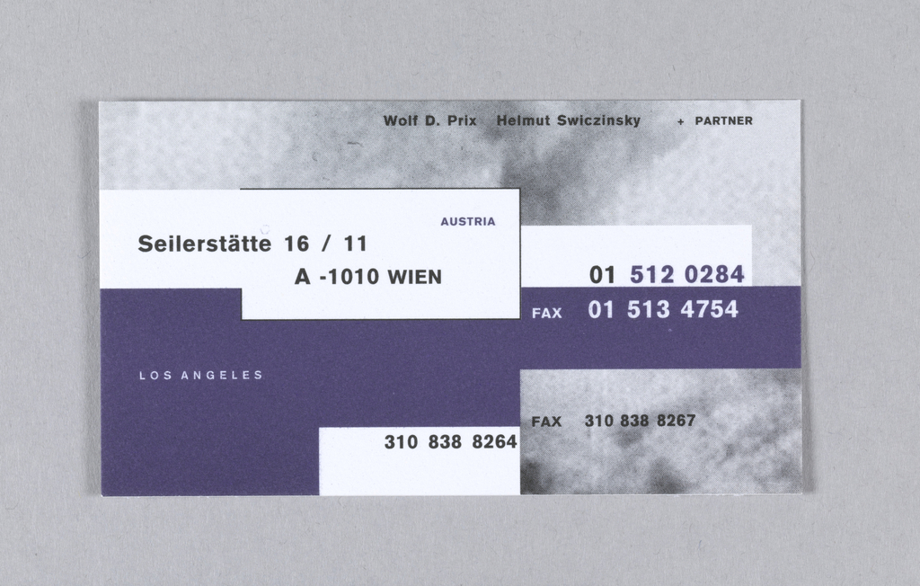 Business card with overlapping boxes of deep blue, white and gray-white cloud image. Text is in black, deep blue and white; upper margin: Wolf D. Prix Helmut Swiczinsky  +PARTNER / Seilerstätte 16/11  A-1010 WIEN AUSTRIA  01 512 0284 / 01 513 4754; LOS ANGELES; 310 838 8264; FAX 310 838 8267.