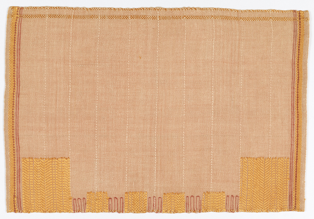 Placemat with narrow striped borders on left and right sides in orange and red. Orange and red squares in different sizes along the bottom edge.