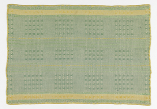 Tablemat with green and orange stripes and a repeating grid of small openwork squares.