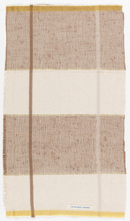 Sample composed of wide bands of creams woven with brown and cream on its own. A solid brown stripe traverses vertically the left side.