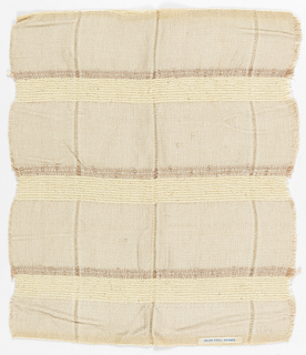 Sample woven in varied tones of cream; squares divided by horizontals and verticals of different widths.