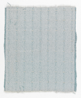 Woven chevron pattern in turquoise and gray.