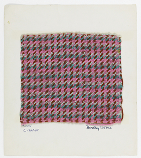 Sample of hound's-tooth plaid with a warp of pink and red two-ply yarn and a weft of green two-ply yarns, light blue boucle, pink two-ply yarns and flat pink metallic yarns.