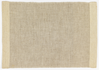 Beige and white placemat with slightly raised bands in off-white at each edge, with bands of heavier weft to create pattern