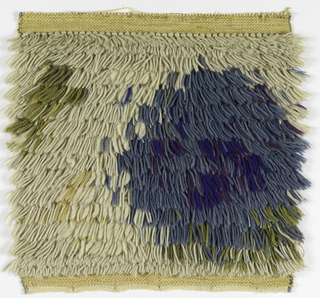 Sampler for a knotted pile rug or hanging woven in off-white with circular shape in shades of blue and green.