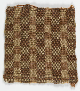 A sample woven in rust, brown and tan.