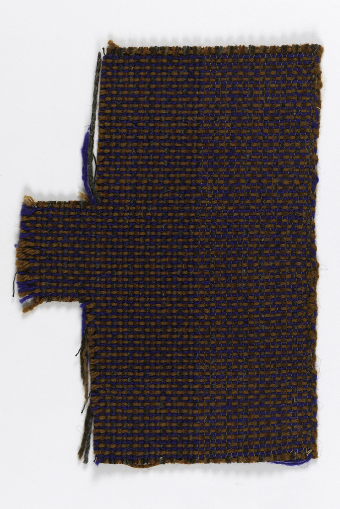 Hand woven, two sided, warp oriented on one side in brown, rust and gray, and weft oriented on the other in brown and blue.
