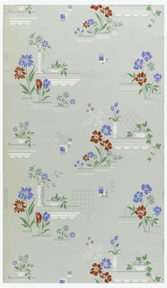 Red and blue flowers with white geometrics with metallic silver on a pale green ground.