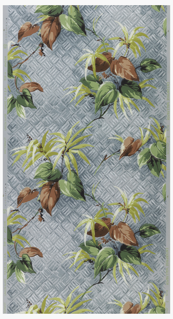 Exotic foliage of yellow plants with red and green leaves on a white and blue woven background on a blue ground.