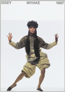 Photograph of a model, in animated position, wearing an oversized, short beige jumpsuit. Above, black text in caps: ISSEY MIYAKE 1987.