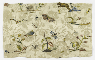 Cream-white damask embroidered with silk and metallic thread in a fantastic design of animals, insects and flowers.
