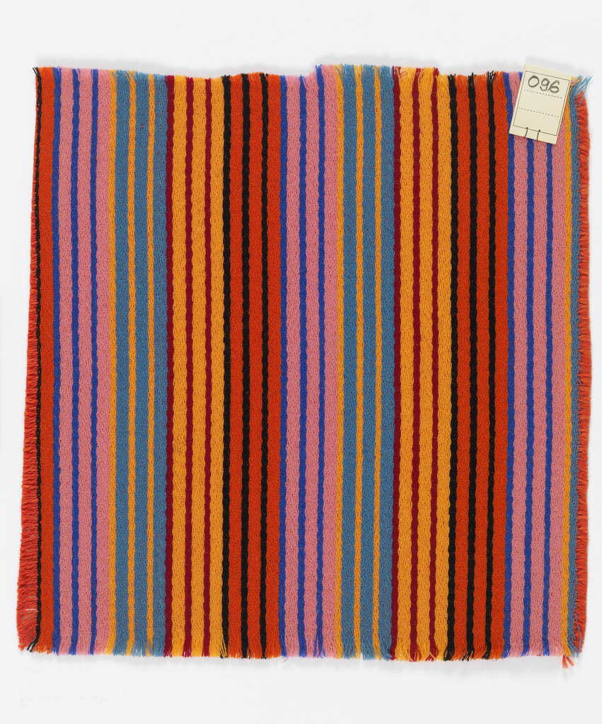 Warp-faced twill weave in narrow vertical stripes of blue-grey, light orange, pink, blue, red, black and maroon. Binding weft threads in red-orange on the reverse.