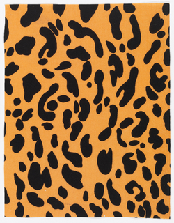 Black leopard spots on an orange ground.