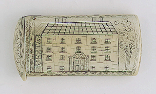 """Oblong, curved lid and bottom, featuring engraved decoration, situated horizontally on case body, of Georgian style house, with four chimneys, four rows of windows, front door flanked by classical columns and fanlight above, a tree on right side of house, on left side of house """"Vestas"""" is inscribed (to be read if case is turned upright), all is framed by decorative border. Reverse features engraved decoration, situated vertically on case body, of flower bouquet in vase on stand. Top of lid, located to left of house, features engraved flower surrounded by decorative border, thumb catch protrudes slightly over box edge, hinged on side. Striker on box bottom carved into ivory with hatch marks."""