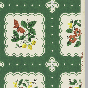 White scalloped squares containing designs of red birds or flowers and yellow butterflies. Dots and cinquefeuille flowers of white and metallic silver are background design on a green ground.