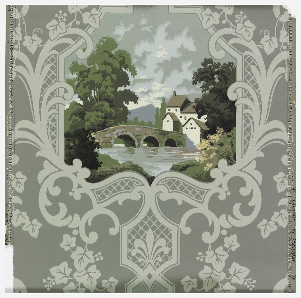 Landscape scene of large house with bridge framed by a scroll design with ivy of a light green on a green-grey ground.