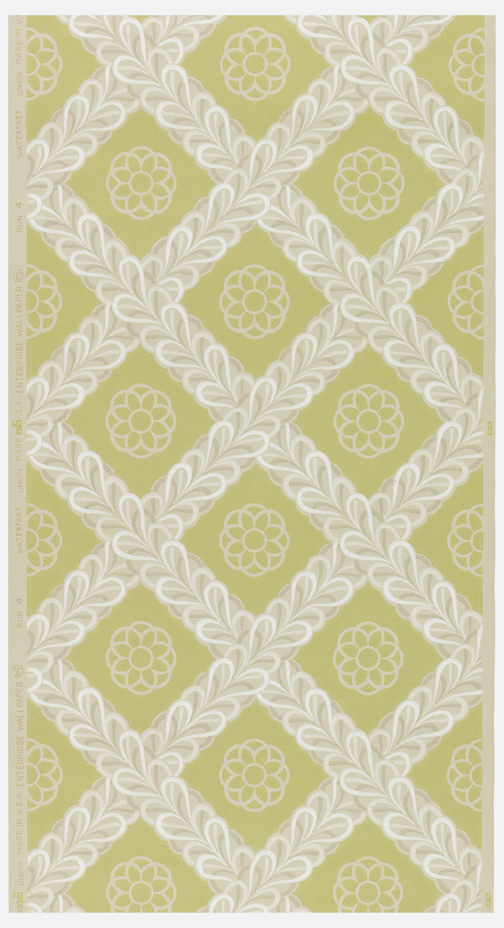 Dull lime green background with white lattice; white flower in center of each space on a beige ground.
