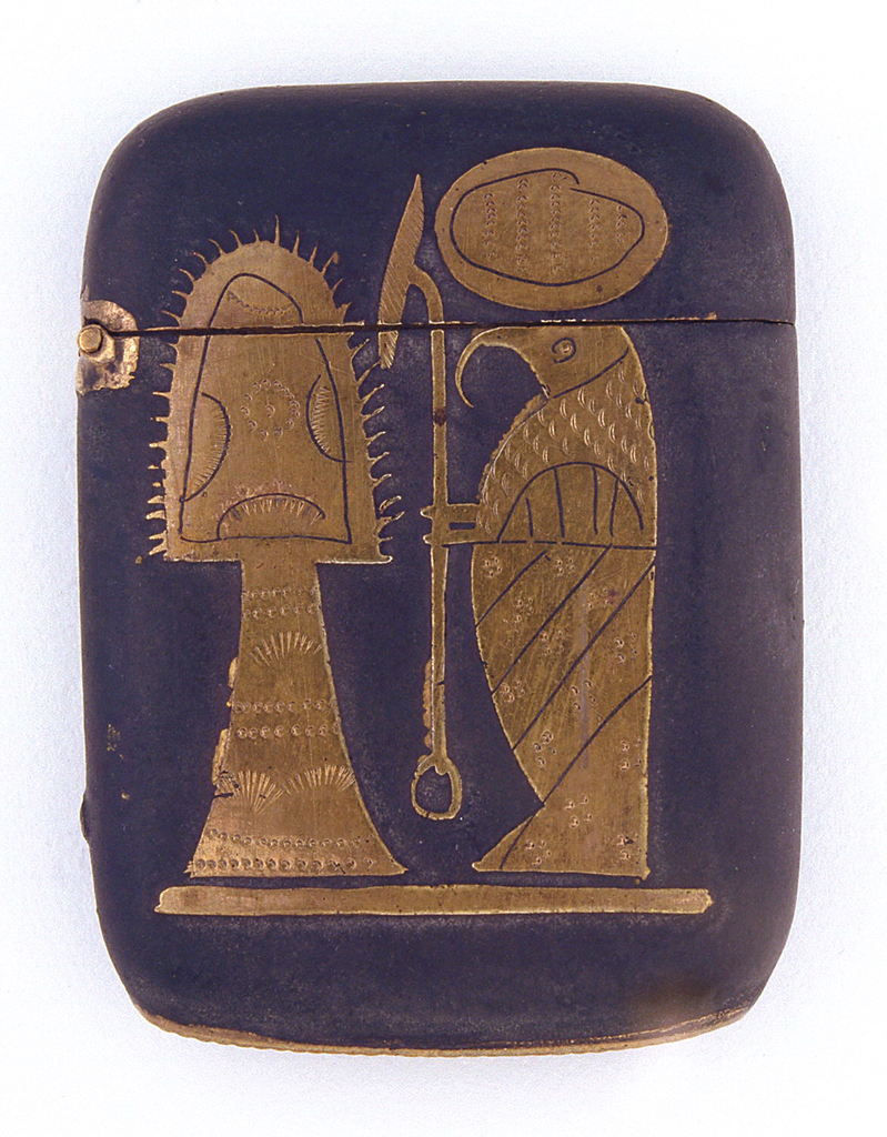 Rectangular, curved sides and corners, featuring raised and incised decoration in brass against dark ground, of Egyptian hieroglyphs, possibly vulture figure of 'Alef on front, among other symbols on front and reverse. Lid hinged on side. Striker in recessed groove on bottom.