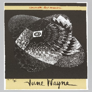 """Poster for the Cincinnati Art Museum exhibition, """"Lithographs by June Wayne: A Retrospective,"""" in September of 1969. Poster depicts an abstract drawing of black and white design of rounded forms with patterns against a black ground. The image is a version of Wayne's earlier print, """"Target"""" which wad produced in February 1951. Above, in red, script text over a tan-colored, horizontal band: Cincinnati Art museum; below, in black, script text: June Wayne. Lower left, under the left corner of the black and white image: the target '51 [monogram]."""