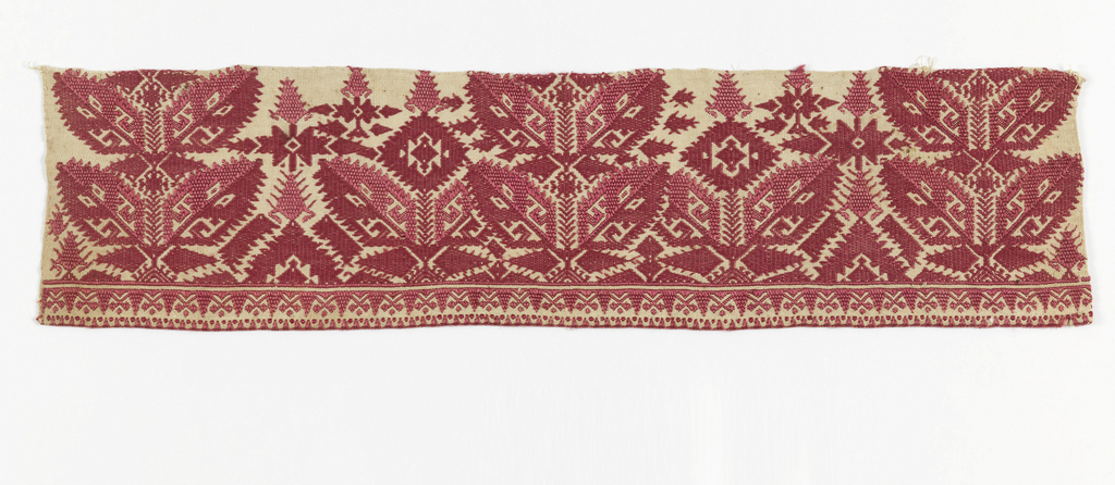 Strip embroidered in two shades of red silk in conventionalized plant forms and a narrow border of triangles and crosses.