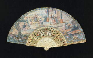 Pleated fan. Obverse shows a King returning from war being greeted by a group of women dancing and playing musical instruments. Trophies of musical instruments to the right and left. On the reverse, two women in a landscape setting. Sticks are carved (à jour), gilded and painted. At center are two couples: the men are standing, the women are seated. Red jewels set in each end of the pin.