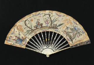 Pleated fan. Linen leaf painted with gouache.  Design showing a central scene of a young man seated on a bench near a standing woman holding a long floral garland. A bird flies above them carrying a note in its beak. Altar of love at the left and a cartouche with trophies at right. Design outlined in silvered chain stitch. Embroidered with spangles. Gilt flourishes near the edges and gilt medallions on either side of the central scene. Sequins on trees and cartouche. Carved and gilded ivory sticks with silver and touches of red.