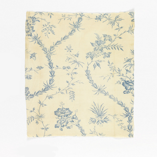 Textile fragment printed in blue on white showing scattered florals with serpentine stems.