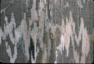 Hanging of linen, wool and silk; open weave construction in white and shades of gray and light brown. Abstract pattern of curving lines.
