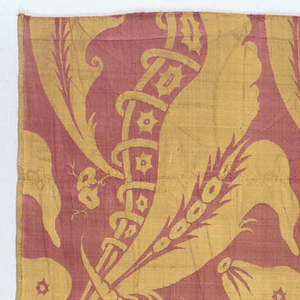 Fragment of silk composed of several pieces sewn together. Yellow and salmon damask showing design of exotic fruits and vegetation in the 'bizarre' style.